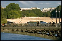Steel and stone bridges over the Seine River. Paris, France ( color)