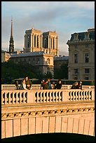 Watching the sunset from a bridge, with Notre Dame towers behind. Paris, France ( color)