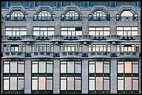 Glass windows of the Samaritaine reflecting colors of sunset. Paris, France ( color)