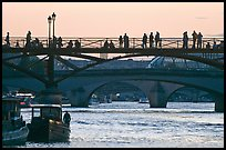 Seine river and people silhouettes on Pont des Arts. Paris, France (color)