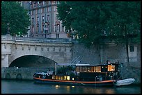 Lighted live-in barge, quay, and Pont-Neuf. Paris, France ( color)
