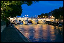 Quay, Seine River, and Pont-Neuf at night. Paris, France (color)