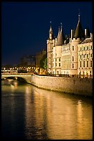 Conciergerie reflected in Seine river at night. Paris, France