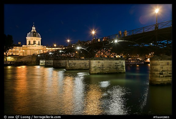 Institut de France, Pont des Arts and Seine reflections at night. Paris, France