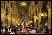 Interior of Notre-Dame de Paris during mass. Paris, France