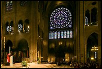 Bishop celebrating mass, South transept, and stained glass rose. Paris, France (color)