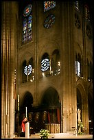 Cardinal reading and choir of Notre-Dame cathedral. Paris, France (color)