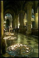 Candles in aisle, Notre-Dame-de-Paris. Paris, France (color)