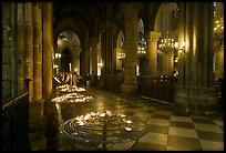 North Aisle and candles, cathedral Notre-Dame-de-Paris. Paris, France (color)