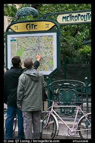 Men looking at a map of the Metro outside Cite station. Paris, France (color)
