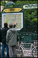 Men looking at a map of the Metro outside Cite station. Paris, France ( color)