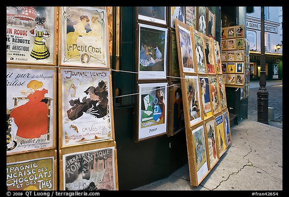 Reproduction of period posters for sale, Montmartre. Paris, France