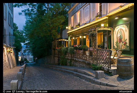 Cobblestone street and restaurant at dusk, Montmartre. Paris, France (color)