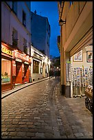 Pedestrian cobblestone street and tourist business, Montmartre. Paris, France