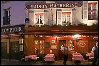 Restaurant and waiter at night, Montmartre. Paris, France