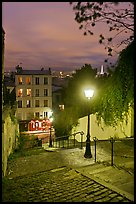 Hillside stairs, street lights, and Eiffel Tower in the distance, Montmartre. Paris, France (color)