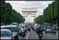 Car and motorcycle traffic and Arc de Triomphe, Champs-Elysees. Paris, France ( color)