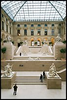 Tourists and exhibit inside Louvre museum. Paris, France (color)