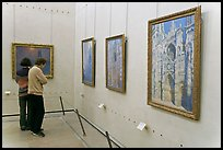 Visitors looking at Monet's Rouen Cathedral, Orsay Museum. Paris, France ( color)
