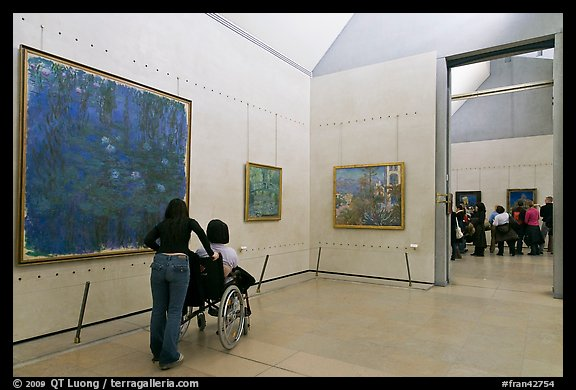 Visitor in wheelchair, Orsay Museum. Paris, France (color)