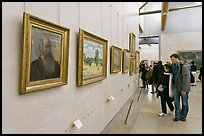 Couple looking at impressionists paintings, Orsay Museum. Paris, France ( color)