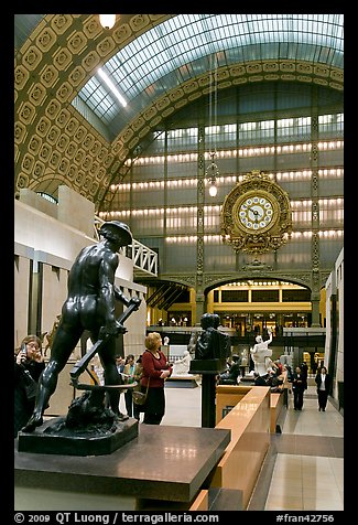 Sculpture and historic clock inside Orsay Museum. Paris, France