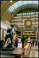 Sculpture and historic clock inside Orsay Museum. Paris, France ( color)