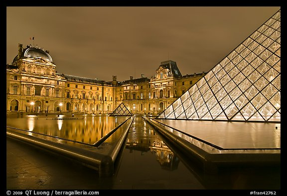 IM Pei Pyramid and Sully Wing at night, The Louvre. Paris, France