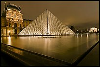 IM Pei Pyramid and reflection ponds at night, The Louvre. Paris, France