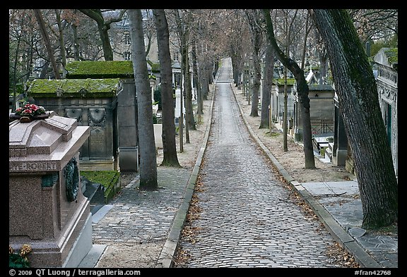Alley and tombs in winter, Pere Lachaise cemetery. Paris, France