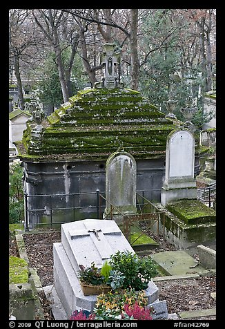 Mossy tombs, Pere Lachaise cemetery. Paris, France (color)