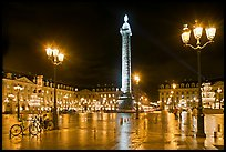 Place Vendome glistening at night. Paris, France (color)