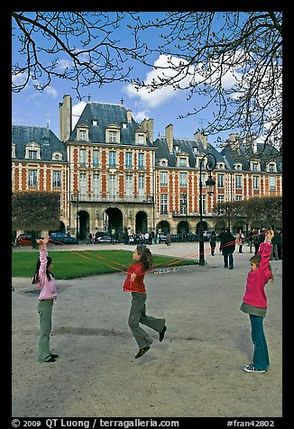 Girls playing with rope, Place des Vosges. Paris, France (color)