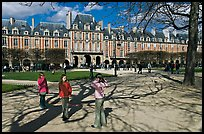 Girls playing in park, Place des Vosges. Paris, France