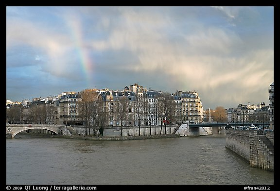 Clearing storm with rainbow above Saint Louis Island. Paris, France