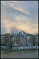 Riverfront houses on Ile Saint Louis with rainbow. Paris, France