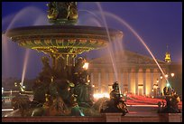 Fountain on Place de la Concorde and Assemblee Nationale by night. Paris, France