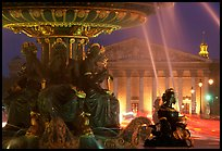 Fountain on Place de la Concorde and Assemblee Nationale by night. Paris, France (color)