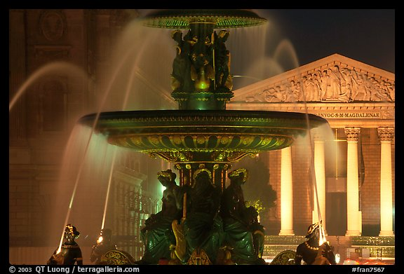 Fountain on Place de la Concorde and Madeleine church at night. Paris, France