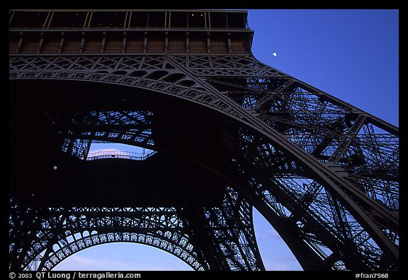 Base of Tour Eiffel (Eiffel Tower) with moon. Paris, France