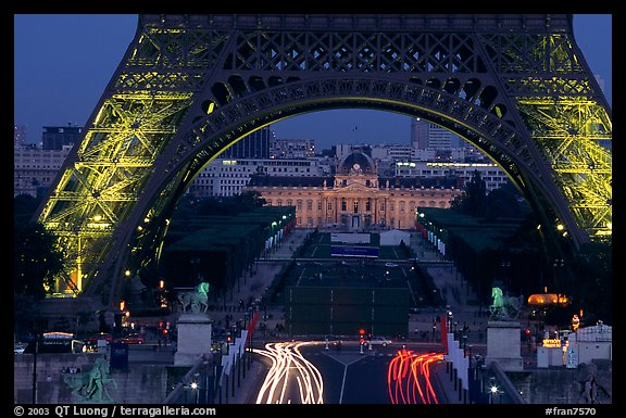 Ecole Militaire (Military Academy) seen through Tour Eiffel  at dusk. Paris, France