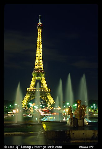 Tour Eiffel (Eiffel Tower) and Fountains on the Palais de Chaillot by night. Paris, France (color)