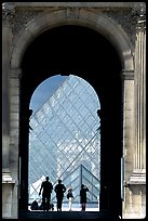 Pyramid seen through one of the Louvre's Gates. Paris, France