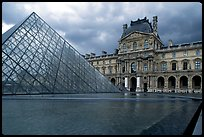 Pyramid and Richelieu wing of the Louvre under dark clouds. Paris, France (color)