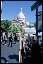 Painter on Place du Tertre, with the Sacre Coeur in the background, Montmartre. Paris, France