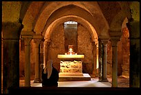 Crypte of the Romanesque church of Vezelay with Nun in prayer. Burgundy, France (color)