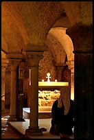 Nun in prayer in the Crypte of the Romanesque church of Vezelay. Burgundy, France
