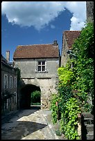 Street and old town gate, Vezelay. Burgundy, France (color)