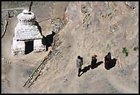 People ascending a trail past a chorten below Phuktal,  Zanskar, Jammu and Kashmir. India (color)