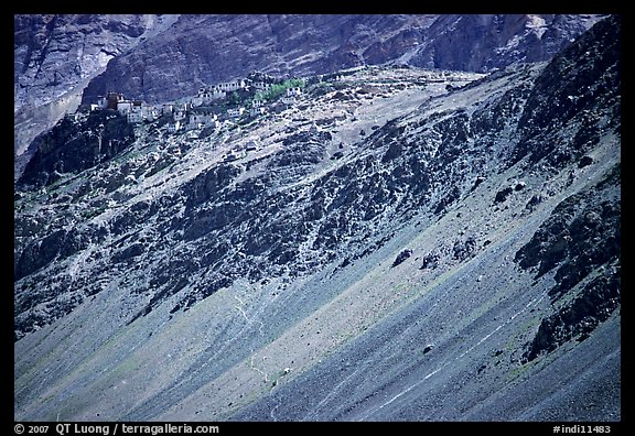 Rocky slopes topped by village and gompa, Zanskar, Jammu and Kashmir. India (color)